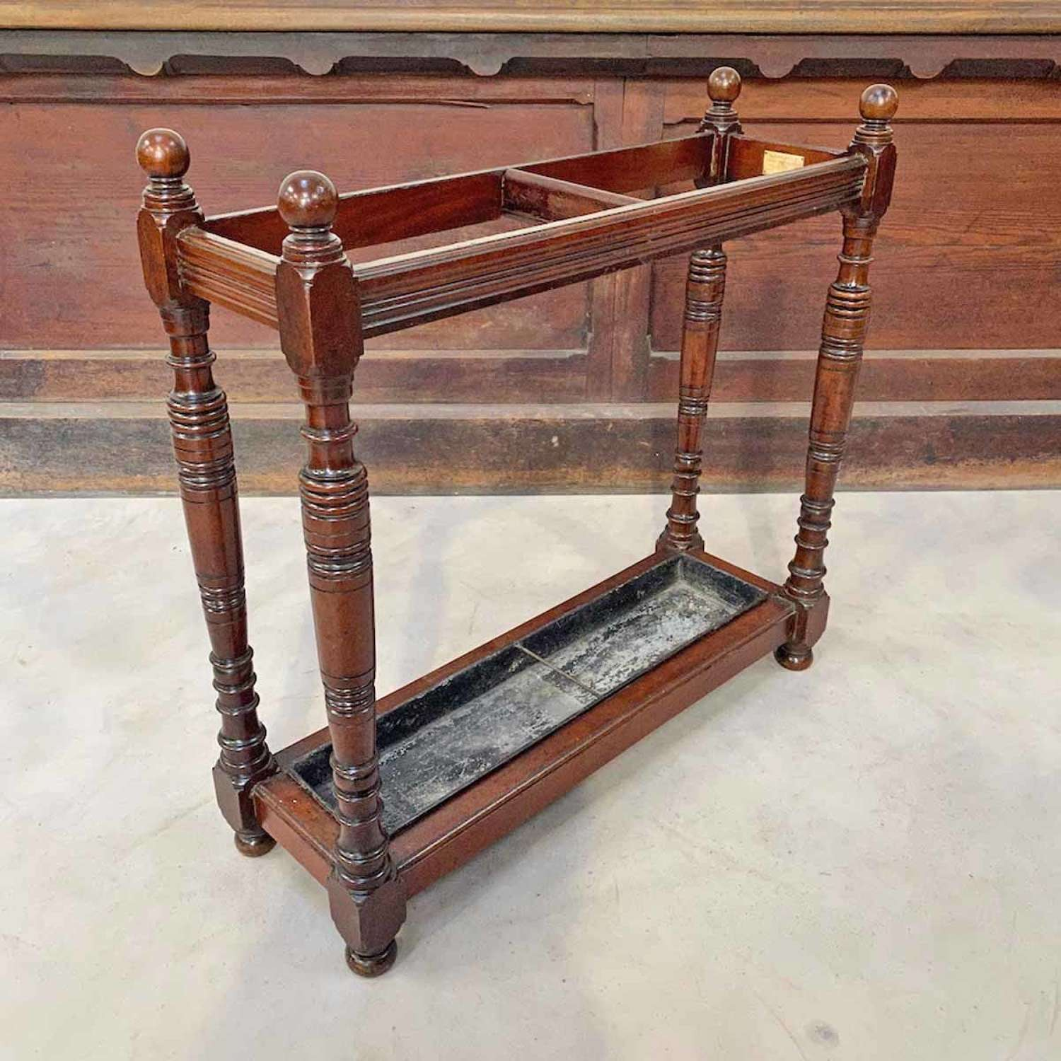 Walnut stick stand - by Goodall of Manchester