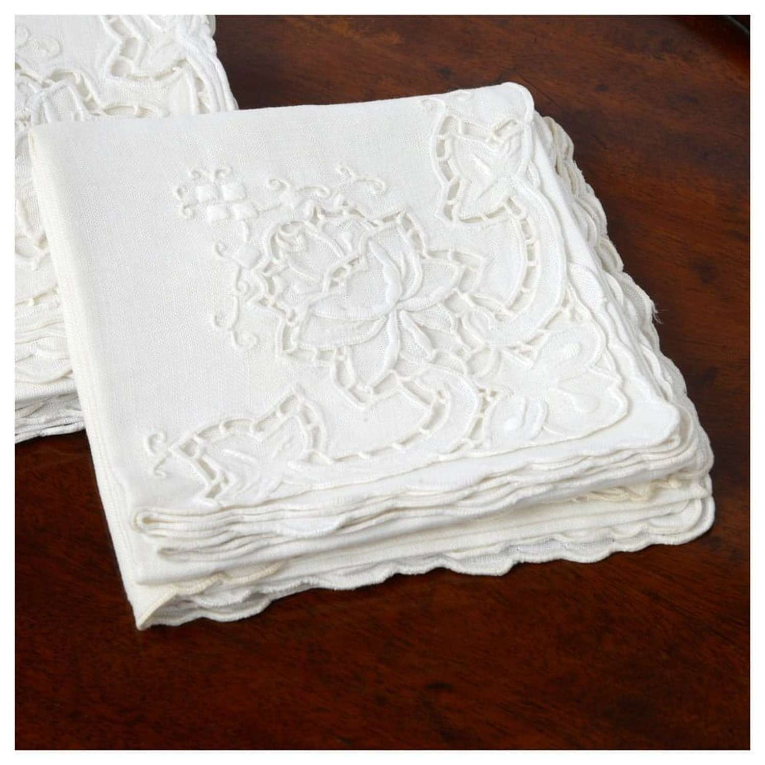 A set of 6 embroidered linen napkins
