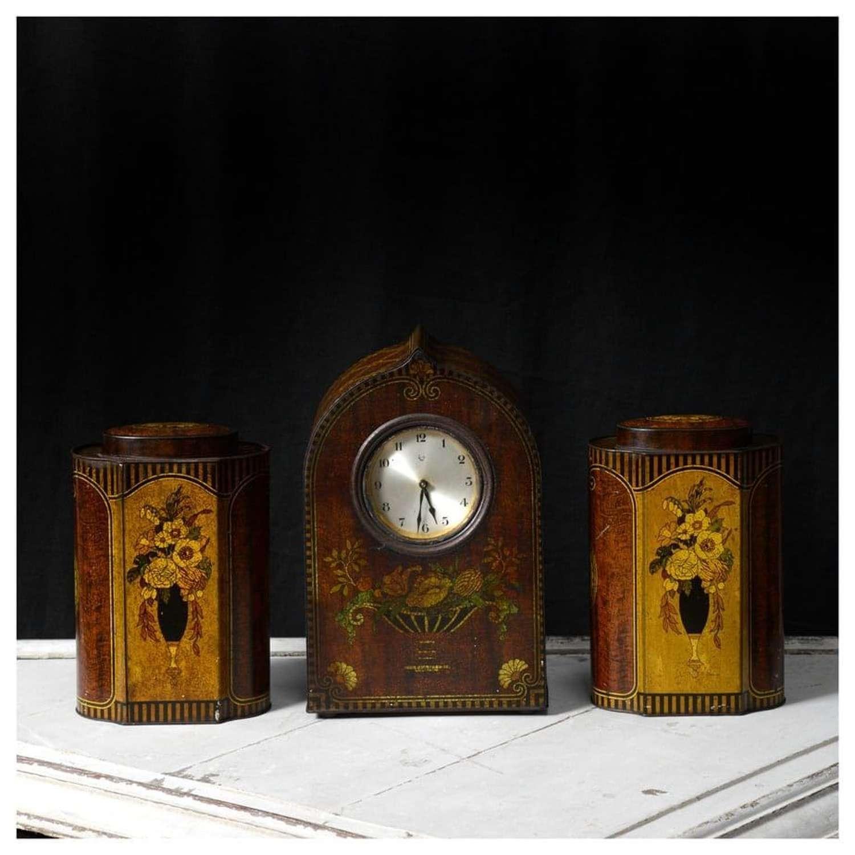 Tinplate biscuit tin clock garniture