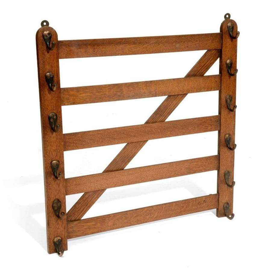 Oak whip-rack in the form of a 5 bar gate