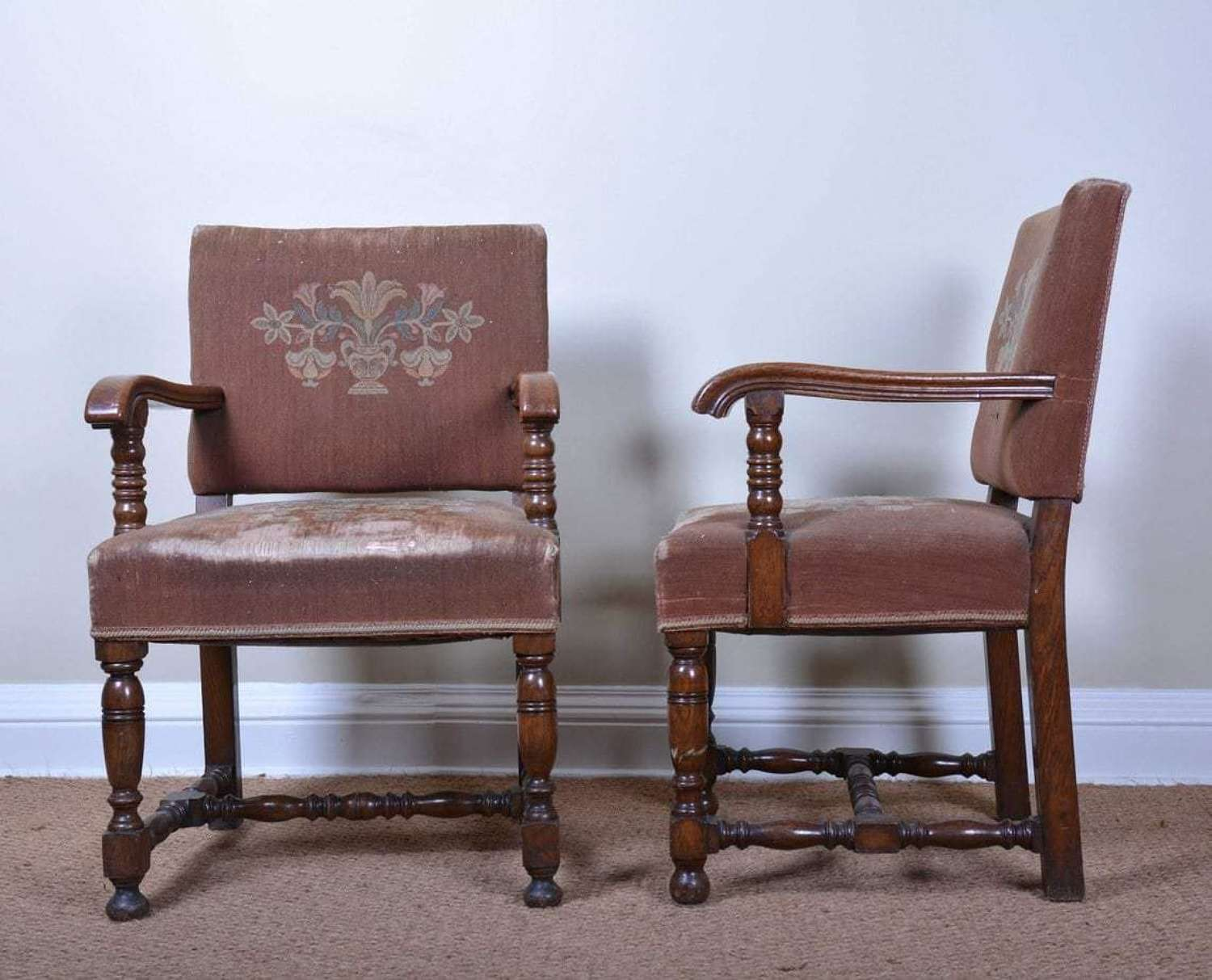 Pair of oak Arts and Crafts open arm chairs
