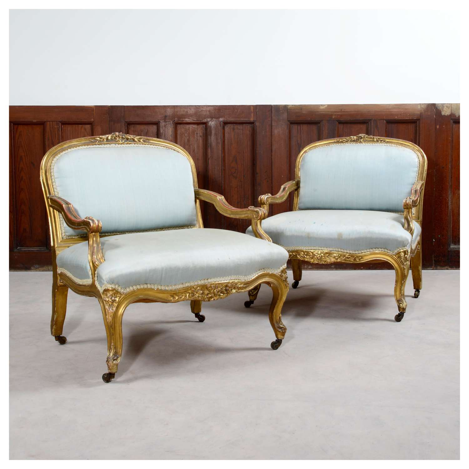 Pair of French Louis XV style gilt bedroom armchairs