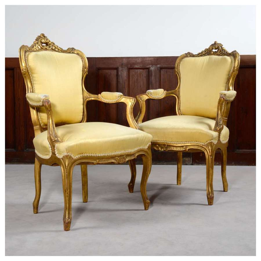 Pair of French Louis XV style gilt armchairs, or fauteuils