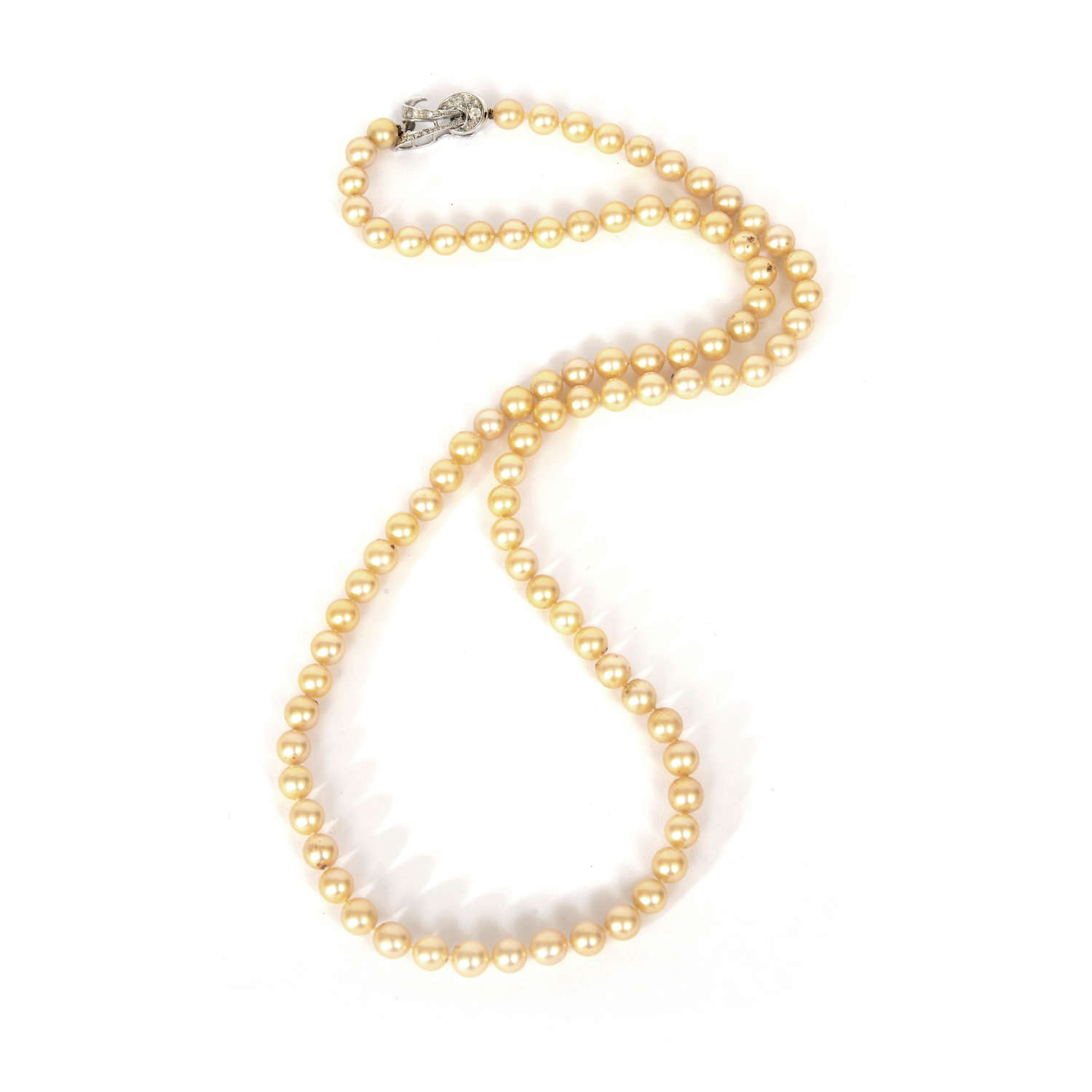 A cultured pearl necklace on diamond clasp.