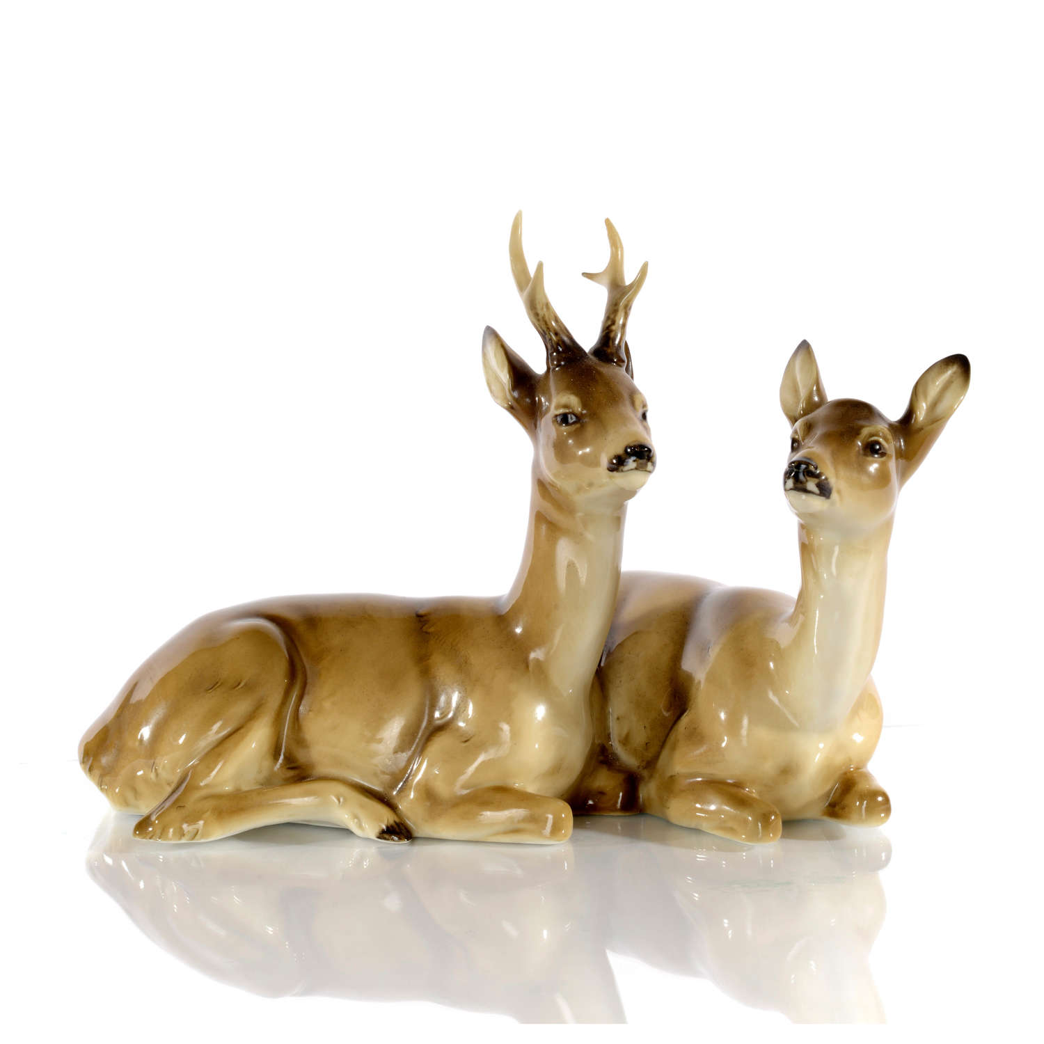 A German porcelain figure group of a Roe Buck and Doe by Max Hermann.