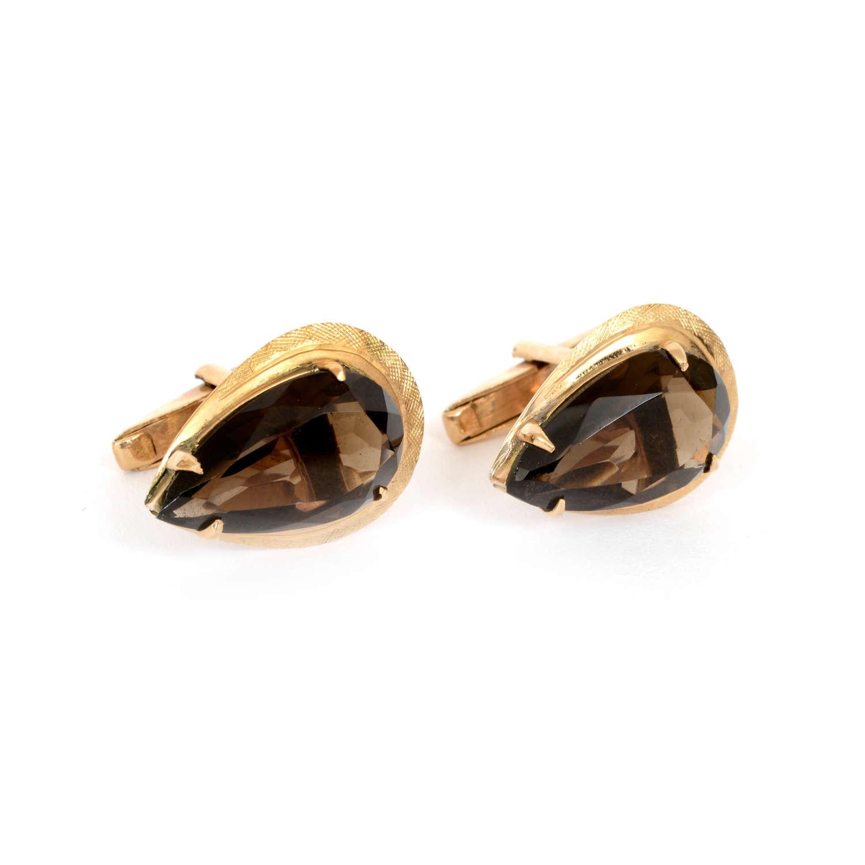 A pair of smoky quartz and gold cufflinks.